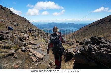 Tongariro, New Zealand - December 27, 2019 : People Trekking At Tongariro Alpine Crossing In New Zea