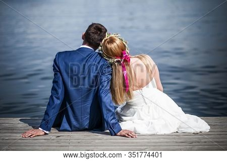 Wedding Photography In Nature. Bride And Groom By The Lake. Empty Copy Space Outdoor Photoshoot. You