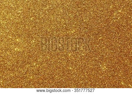 The Picture Shows A Background With Golden Glittery Paper