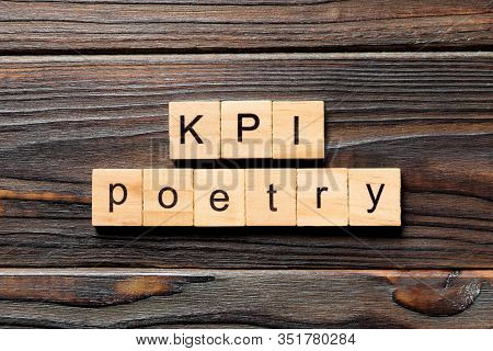 Kpi Poetry Word Written On Wood Block. Kpi Poetry Text On Table, Concept