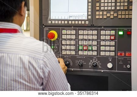 The Cnc Milling Machine Operator With Control Board. The Operation Of Cnc Machining Center By Skill