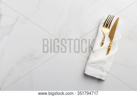 Fork And Knife At White Napkin On White Background Copy Space. Tableware At White Napkin On White Ma