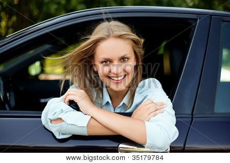 Young Happy Driver Sitting In Car