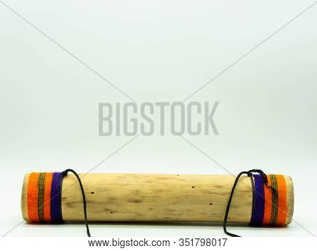 Handmade Wooden Rain Stick Lying On A White Background At The Bottom Of The Image. Ambient Sound. Pe