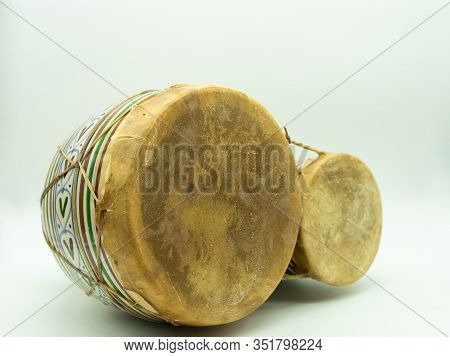 Moroccan Bongos Lying Isolated On A White Background Traditional Moroccan Instrument. Concept Musica