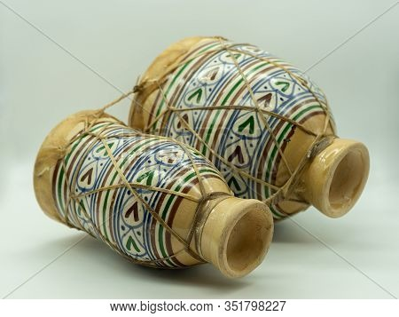 Moroccan Drums Lying Isolated On A White Background. Traditional Moroccan Instrument. Concept Musica