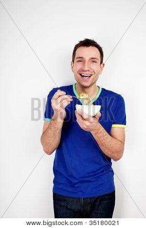 Young Smiling Man Eating Musli