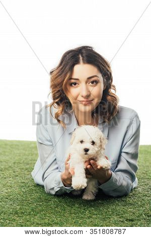 Smiling Woman Holding Havanese Puppy And Lying On Grass Isolated On White