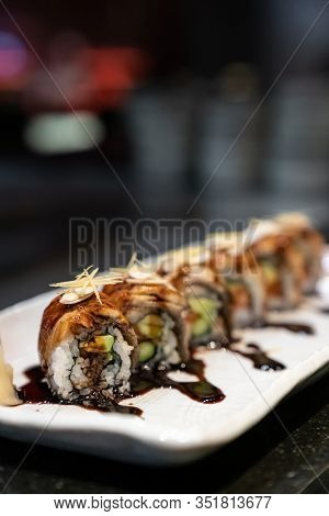 Traditional japanese food cuisine Unagi roll, japanese ell serve with japanese rice and avocado with special sauce.