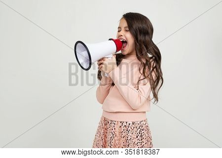 European Cute Smiling Teenager Girl With A Megaphone Reports The News With A Megaphone In Hands On A