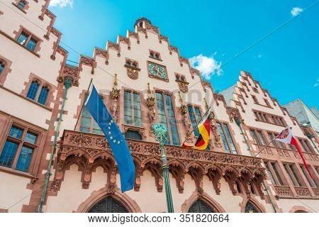 Frankfurt, Germany - June 12, 2019: EU and Germany flags in Frankfurt, Germany.