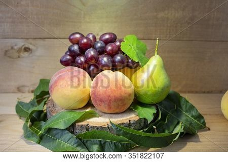 Fresh Fruits. Healthy Food. Mixed Fruit, Peaches, Grapes, Pears. Studio Photography Of Various Fruit