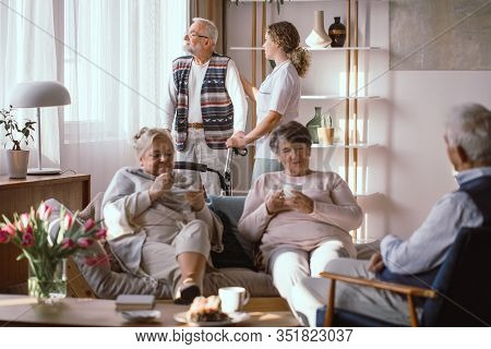 Meeting Of A Group Of Senior People In The Living Room In A Nursing Home