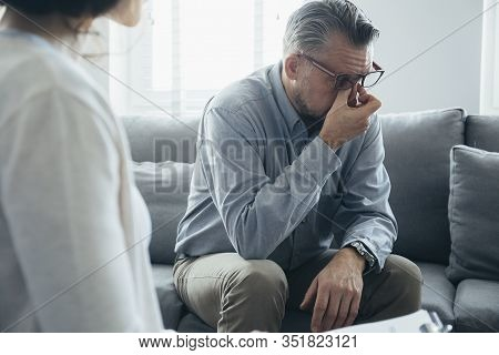 Handsome Man Wipes His Tears While Talking To The Therapist
