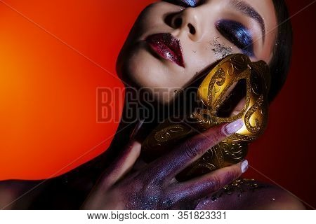 Fashion Portrait Of A Young Woman With Closed Eyes And Creative Make-up, Body Art With A Masquerade