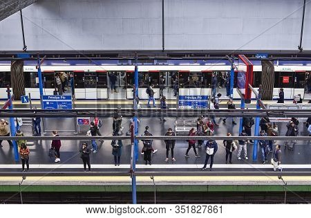 Madrid, Spain - February 17, 2020. People Waiting For A Train In A Metro Subway Station Of Madrid, S