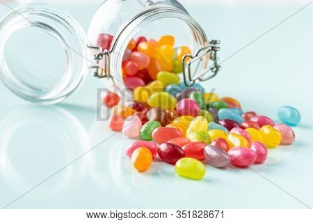 Fruity jellybeans. Tasty colorful jelly beans on colorful background.