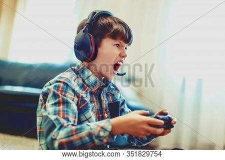 Crazy Dependent Kid Shouting While Playing Mass Multiplayer Video Game Online At Home
