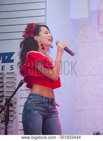 Attractive Singer On The Stage. Singing Of Charming Lady. Beautiful Brunette Woman Singing. Beauty W