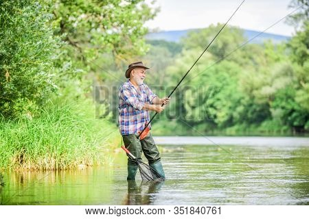 Mature Man Fishing. Male Leisure. Fisherman With Fishing Rod. Happiness Is Rod In Your Hand. Retired