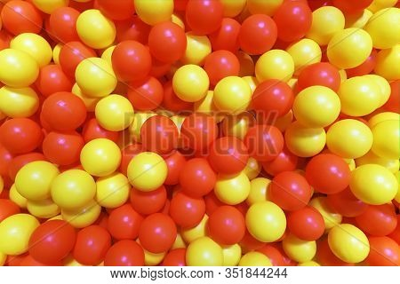 red and yellow balls in the pit