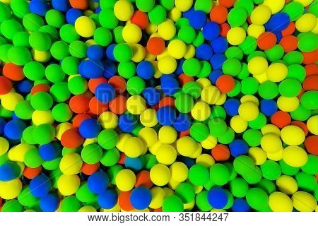 red, green , yellow and blue balls in the pit