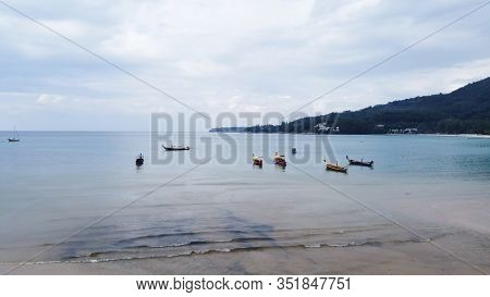 Aerial View Of Beautiful Thai Traditional Wooden Longtail Boat On Phuket Beach.