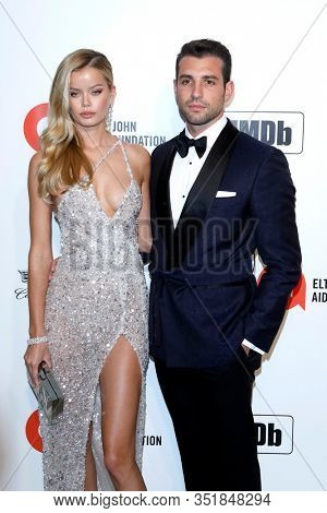 LOS ANGELES - FEB 9:  Frida Aasen, Tommy Chiabra at the 28th Elton John Aids Foundation Viewing Party at the West Hollywood Park on February 9, 2020 in West Hollywood, CA