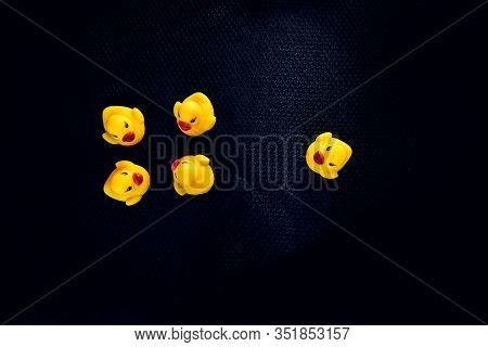 Yellow Rubber Ducks Representing Social Norms And Issues