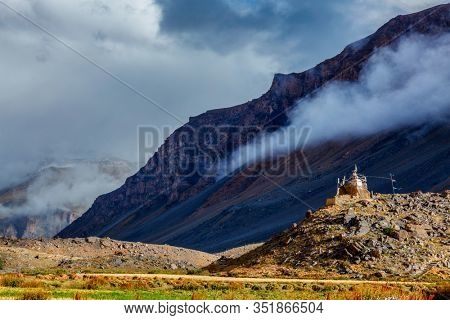 Small Buddhist gompa in Spiti Valley in Himalayas. Himalayan scenic landscape of Himalayas mountains. Himachal Pradesh, India