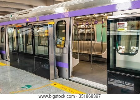 Metro Train Stopping At A Station And Open The Door To Wait For Passengers To Enter During The Rush