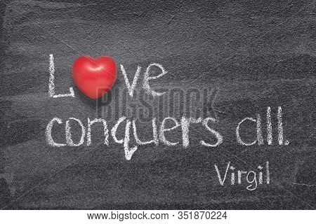 Love Conquers All - Quote Of Ancient Roman Poet Virgil Written On Chalkboard With Red Heart Symbol