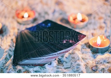 Tarot Card With Candlelight On The Darkness Background For Astrology Occult Magic Illustration / Mag