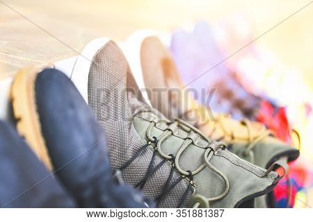 Sneakers Stand In A Line For Sale Second Hand Shoes Or Wash Shoes Dry / Canvas Shoes , Selective Foc
