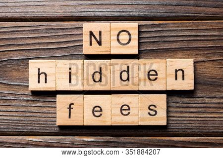 No Hidden Fees Word Written On Wood Block. No Hidden Fees Text On Wooden Table For Your Desing, Top