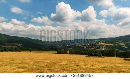 Vrbno Pod Pradedem Town With Hilly Surrouding In Czech Republic During Nice Summer Day With Blue Sky