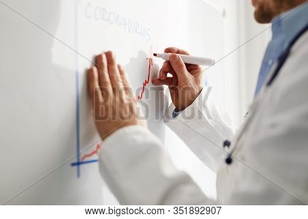 Virus Specialist Draws A Coronavirus Progress Chart On A Whiteboard
