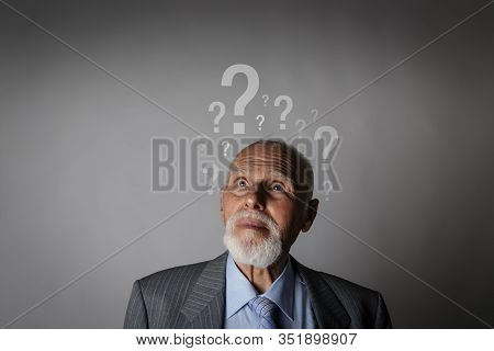 Old Man And Question Marks. Dementia And Ignorance. Confused Old Man.