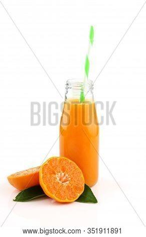 Bottle Of Fresh Orange Juice On White