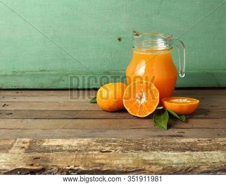 Group Of Orange And Glass Of Juice On Wooden Table