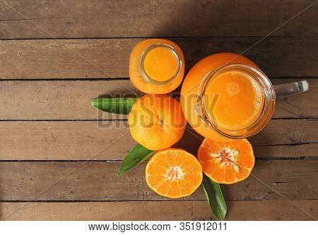 Top View Of Delicious Orange Juice On Wooden Table