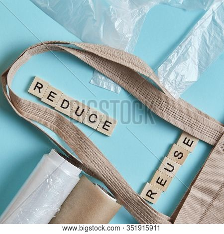 Brown Empty Tote Bag Next To Eco Unfriendly Pouches And Wrap, Reducing Consumer Excess Wraps, Reusab