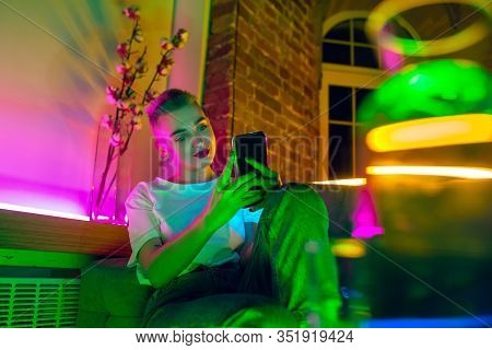 Selfie. Cinematic Portrait Of Stylish Woman In Neon Lighted Interior. Toned Like Cinema Effects, Bri