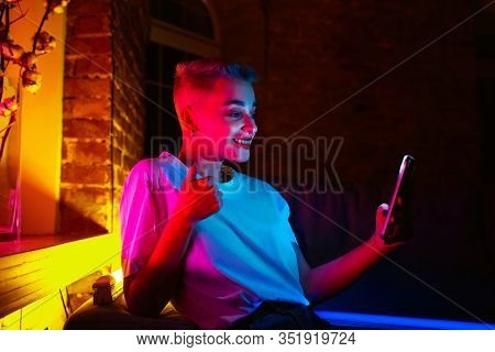 Thumb Up. Cinematic Portrait Of Stylish Woman In Neon Lighted Interior. Toned Like Cinema Effects, B
