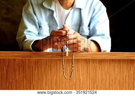 Prayer Pose Of Senior Man Kneel With Hands Holding Rosary Beads Closeup With Jesus Christ Holy Cross