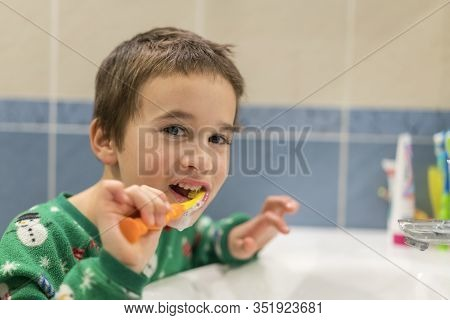 Close-up Of Young Boy Brushing Teeth With Toothbrush Portrait Of Healthy Little Boy Enjoy Cleaning H