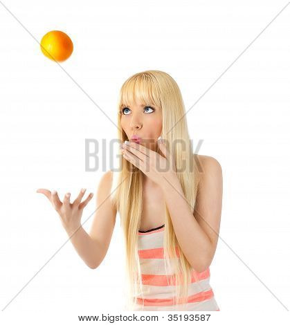 Woman Tossing Up An Orange