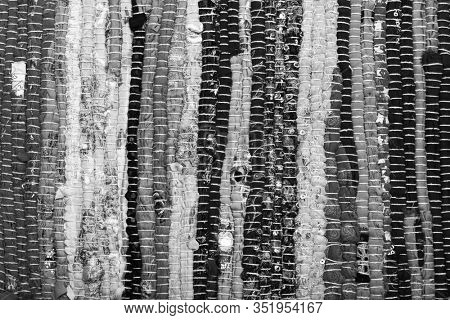 Rustic rug made of fabric flap. Abstract background.