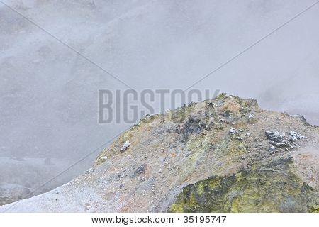 Outcrop of the sulphur deposit near an active fumarole in the Jigokudani Explosion Crater