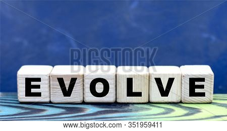 Concept Word Evolve And Skills On Cubes On A Beautiful Blue Background